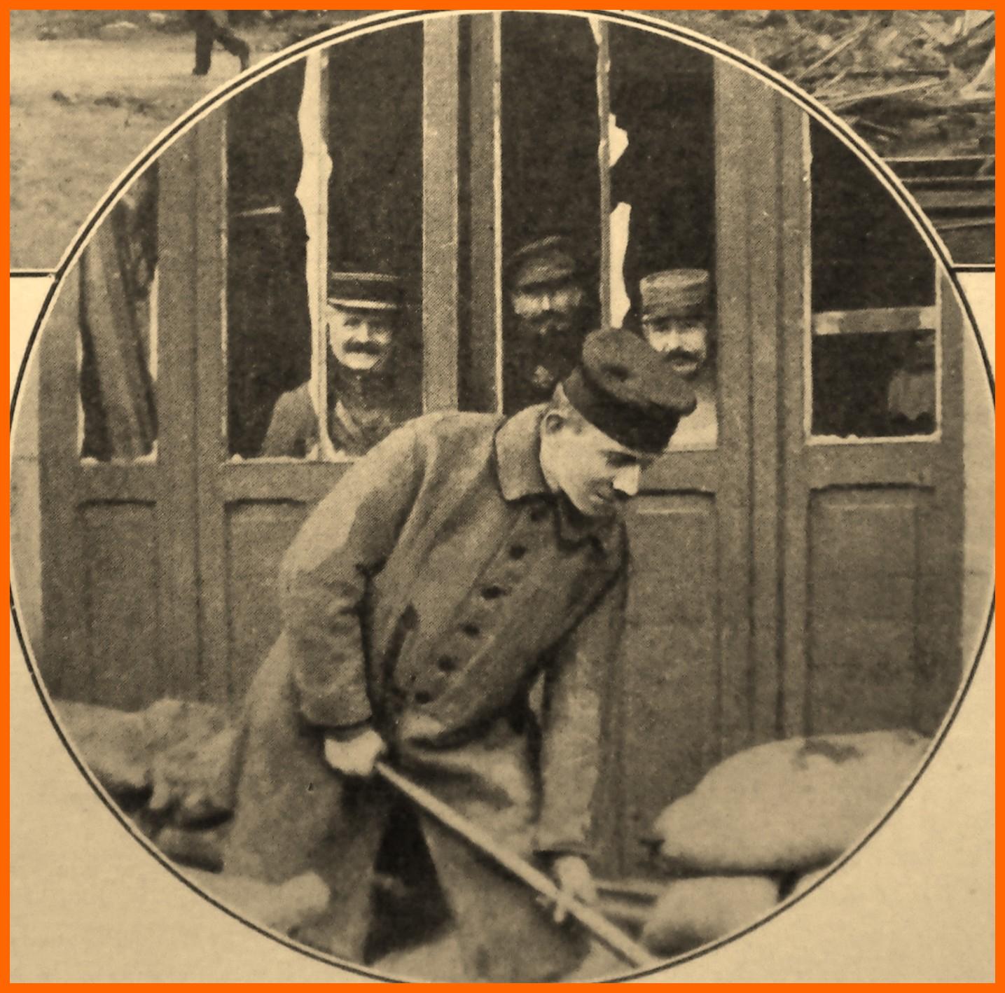 Calais 14 18 prisonnier allemand ramassant des decombres a la gare maritime 25 janvier 1918 encadre
